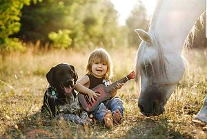 Child and guitar with horse